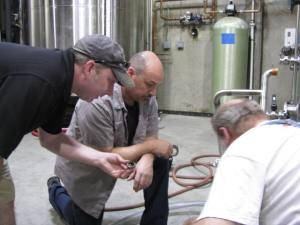 Johnson and Mortensen with a client, Steve Scoville of Little Harpeth Brewing.