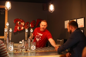 Lakewood's Craig Bradley serving craft beers